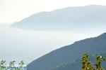 Mistig Skopelos gezien vanaf Alonissos stad | Sporaden | De Griekse Gids - Foto van De Griekse Gids