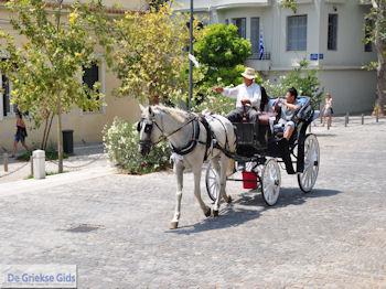 Paard en koets in Athene - Foto van https://www.grieksegids.nl/fotos/athene/athene350/stad-athene-025.jpg