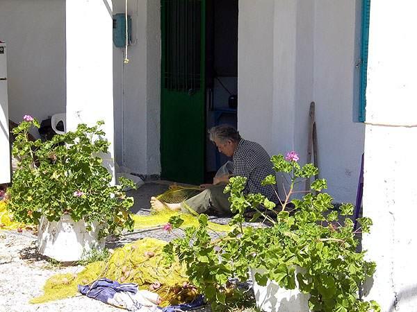 Netten repareren in Syvota, Kefalonia
