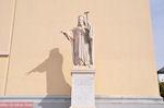 Beeld aan de voorkant van de Atheense universiteit - Foto van De Griekse Gids