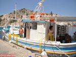 Vissers aan de haven van Symi - Eiland Symi - Foto van De Griekse Gids