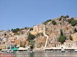 Huizen op de oostelijke berghelling aan de haven - Eiland Symi - Foto van De Griekse Gids