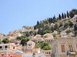 Huizen op berghelling - Eiland Symi - Foto van De Griekse Gids