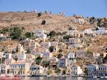 JustGreece.com Een kleurrijke berghelling - Eiland Symi - Foto van De Griekse Gids