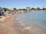 Het strand bij het haventje van Faliraki - Foto van De Griekse Gids