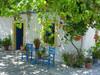 Een typisch Grieks huisje onder de wijnbladeren - Foto van Cecilia